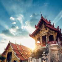 Buddhist Phra Singh Temple at amazing sunset. Tourists favorite landmark in Chiang Mai city centre, Thailand.